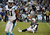 Philip Rivers #17 of the San Diego Chargers sits on the ground after getting tackled during the game against the Carolina Panthers on December 16, 2012 at Qualcomm Stadium in San Diego, California. (Photo by Donald Miralle/Getty Images)