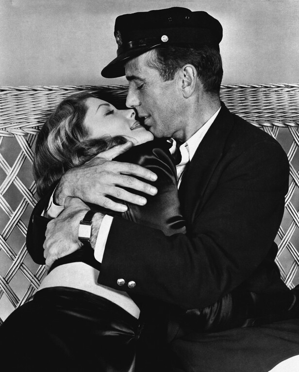 ". FILE - This 1944 file photo originally released by Warner Bros. shows actor Humphrey Bogart, right, holding actress Lauren Bacall in a scene from, ""To Have and Have Not.\"" Bacall, the sultry-voiced actress and Humphrey Bogart�s partner off and on the screen, died Tuesday, Aug. 12, 2014 in New York. She was 89.  (AP Photo, Warner Bros. Pictures, File)"