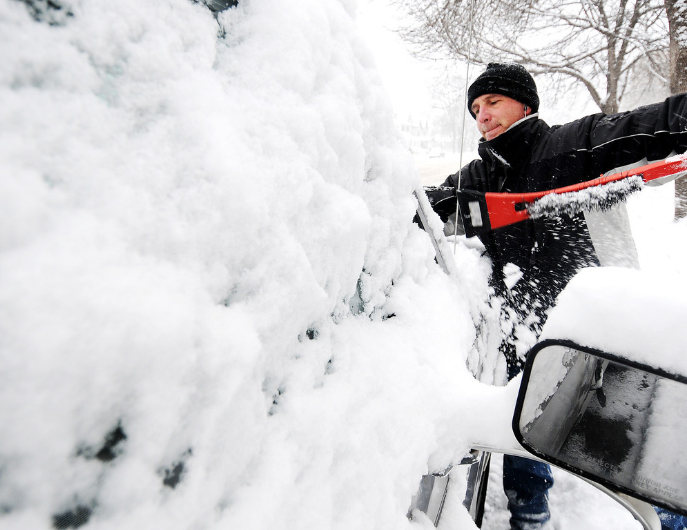 Description of . Joe Jackson clears off snow from his truck on Thursday, Dec. 20, 2012, in Winona, Minn.  The first major snowstorm of the season began its slow eastward march across the Midwest early Thursday, creating treacherous driving conditions and threatening to disrupt some of the nation's busiest airports ahead of the holiday weekend. (AP Photo/Winona Daily News, Joe Ahlquist)