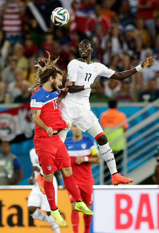 Description of . United States' Kyle Beckerman, left, goes up against Ghana's Mohammed Rabiu for a header during the group G World Cup soccer match between Ghana and the United States at the Arena das Dunas in Natal, Brazil, Monday, June 16, 2014.  (AP Photo/Petr David Josek)
