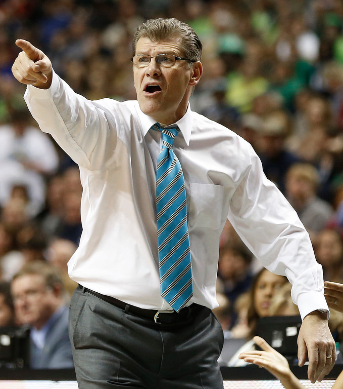 Description of . Connecticut head coach Geno Auriemma watches play against Notre Dame during the second half of the championship game in the Final Four of the NCAA women's college basketball tournament, Tuesday, April 8, 2014, in Nashville, Tenn. (AP Photo/John Bazemore)
