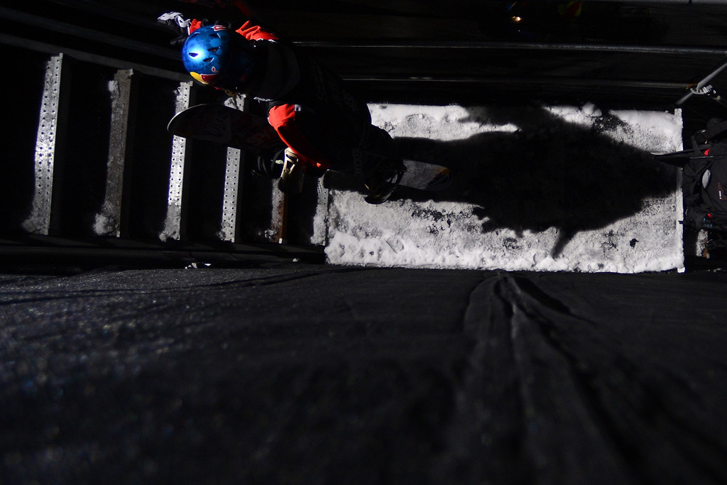 Description of . ASPEN, CO - JANUARY 27: Louie Vito ascends the stairs during the men's snowboard superpipe final. X Games Aspen Buttermilk Mountain January 27, 2013. (Photo By AAron Ontiveroz/The Denver Post)
