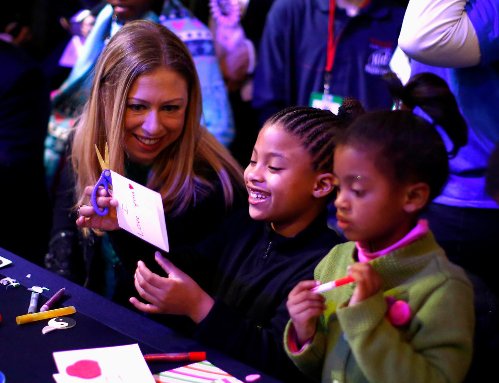 Description of . Chelsea Clinton interacts with children during a National Day of Service event on the National Mall in Washington D.C. January 19, 2013.  REUTERS/Eric Thayer