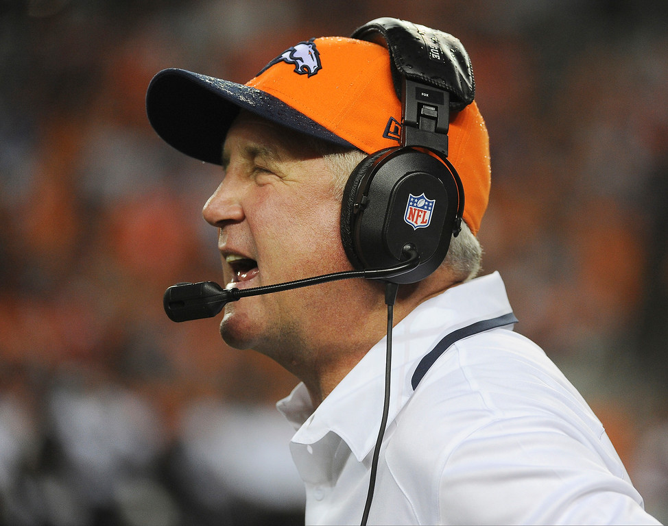 Description of . Denver Broncos head coach John Fox shouts from the sidelines in the first quarter.   (Photo by Tim Rasmussen/The Denver Post)