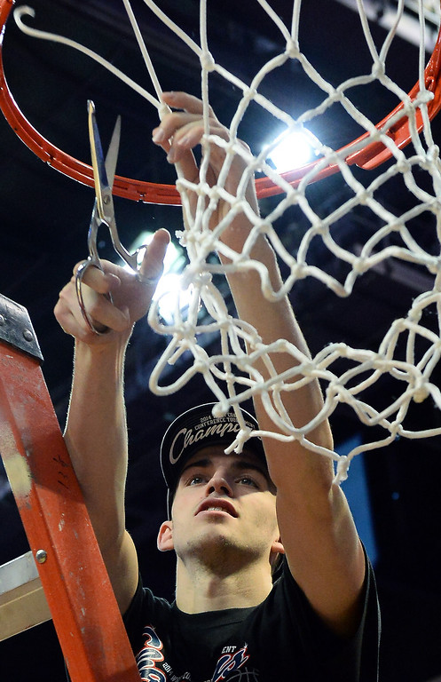 Description of . David Stockton #11 of the Gonzaga Bulldogs cuts down a net after the championship game of the West Coast Conference Basketball tournament at the Orleans Arena on March 11, 2014 in Las Vegas, Nevada. Gonzaga won 75-64.  (Photo by Ethan Miller/Getty Images)