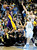 Los Angeles Lakers' Kobe Bryant (L) looks to pass the ball over Denver Nuggets' Corey Brewer and Kosta Koufos (R) during their NBA basketball game in Denver, Colorado February 25, 2013.   REUTERS/Mark Leffingwell