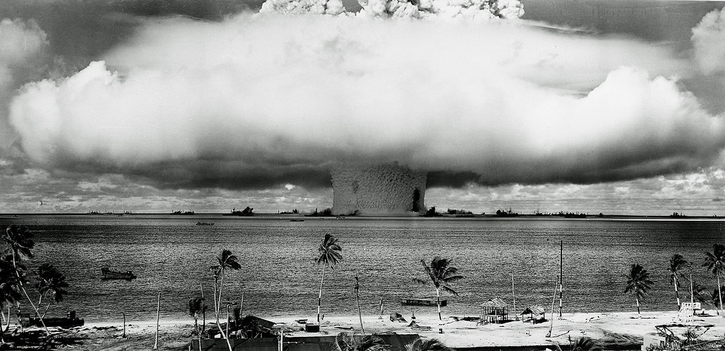 Description of . A massive column of water rises from the sea as the U.S. detonate an atom bomb at Bikini Atoll in the Pacific in the first underwater test of the device, July 25, 1946.   (AP Photo)