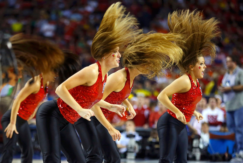 Description of . Louisville Cardinals cheerleaders perform during the NCAA men's Final Four championship basketball game against the Michigan Wolverines in Atlanta, Georgia April 8, 2013.  REUTERS/Jeff Haynes