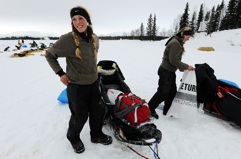 Description of . Kristy Berington, left, and twin sister Anna Berington, right, pack up their sleds as they prepare to leave the Finger Lake checkpoint in Alaska during the Iditarod Trail Sled Dog Race on Monday, March 4, 2013. (AP Photo/The Anchorage Daily News, Bill Roth)