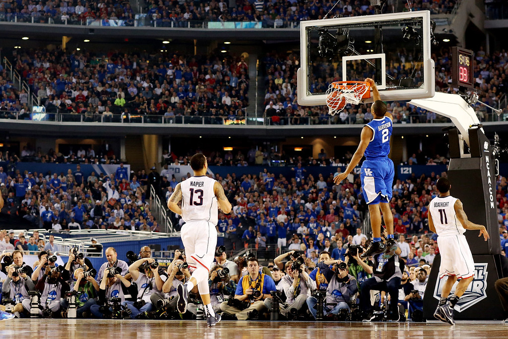 Description of . ARLINGTON, TX - APRIL 07: Aaron Harrison #2 of the Kentucky Wildcats dunks against the Connecticut Huskies during the NCAA Men\'s Final Four Championship at AT&T Stadium on April 7, 2014 in Arlington, Texas.  (Photo by Ronald Martinez/Getty Images)