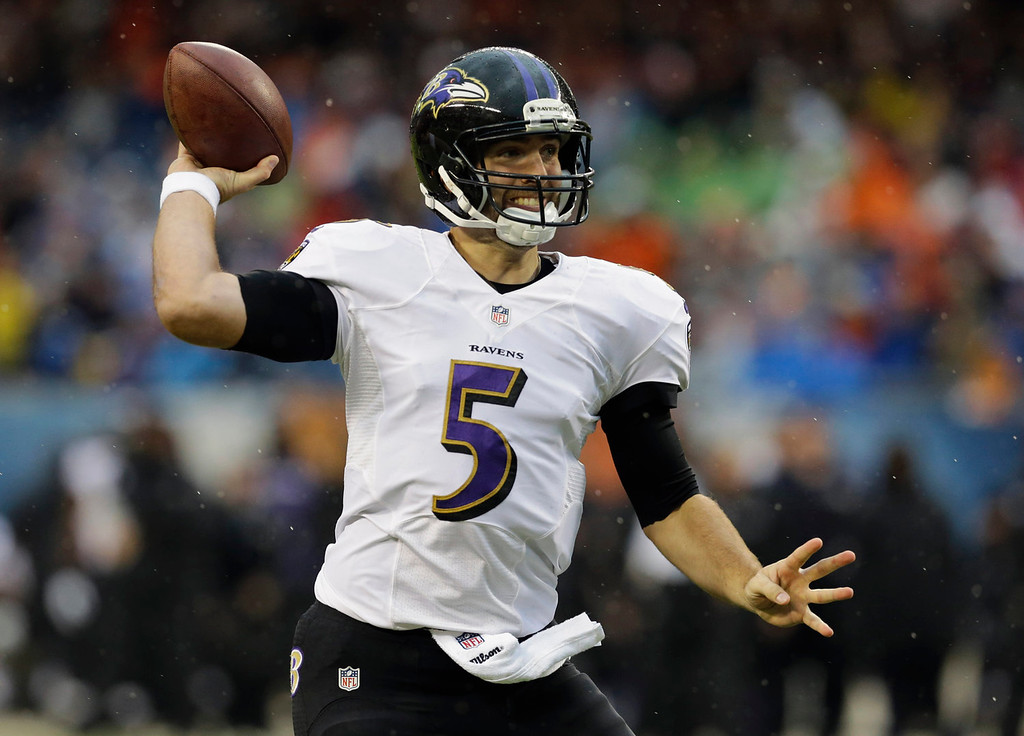 Description of . Baltimore Ravens quarterback Joe Flacco (5) throws a pass during the first half of an NFL football game against the Chicago Bears, Sunday, Nov. 17, 2013, in Chicago. (AP Photo/Nam Y. Huh)