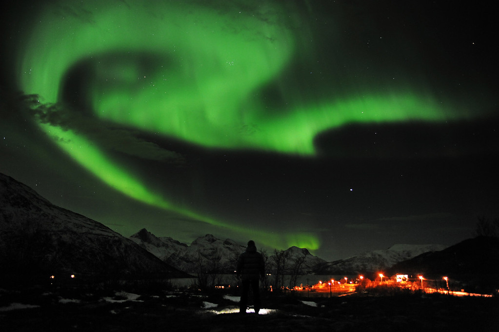 Description of . An Aurora borealis is pictured near the city of Tromsoe, northern Norway, late on January 24, 2012.  (Rune Stoltz Bertinussen/AFP/Getty Images)