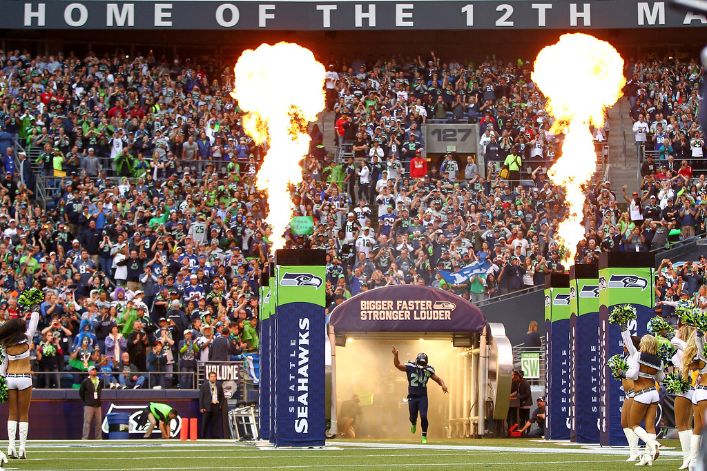 Description of . Marshawn Lynch #24 of the Seattle Seahawks runs on the field prior to the game against the San Francisco 49ers at Qwest Field on September 15, 2013 in Seattle, Washington.  (Photo by Jonathan Ferrey/Getty Images)