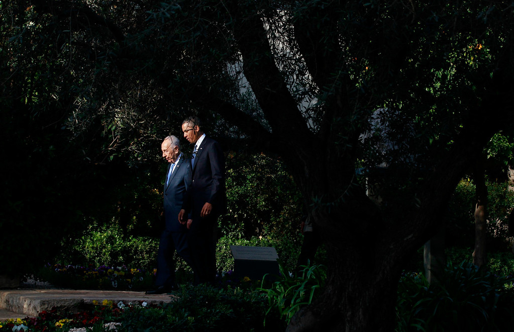 Description of . U.S. President Barack Obama walks in the garden of Israel's President Shimon Peres (L) in Jerusalem March 20, 2013. Making his first official visit to Israel, Obama pledged on Wednesday unwavering commitment to the security of the Jewish State where concern over a nuclear-armed Iran has clouded bilateral relations.  REUTERS/Jason Reed