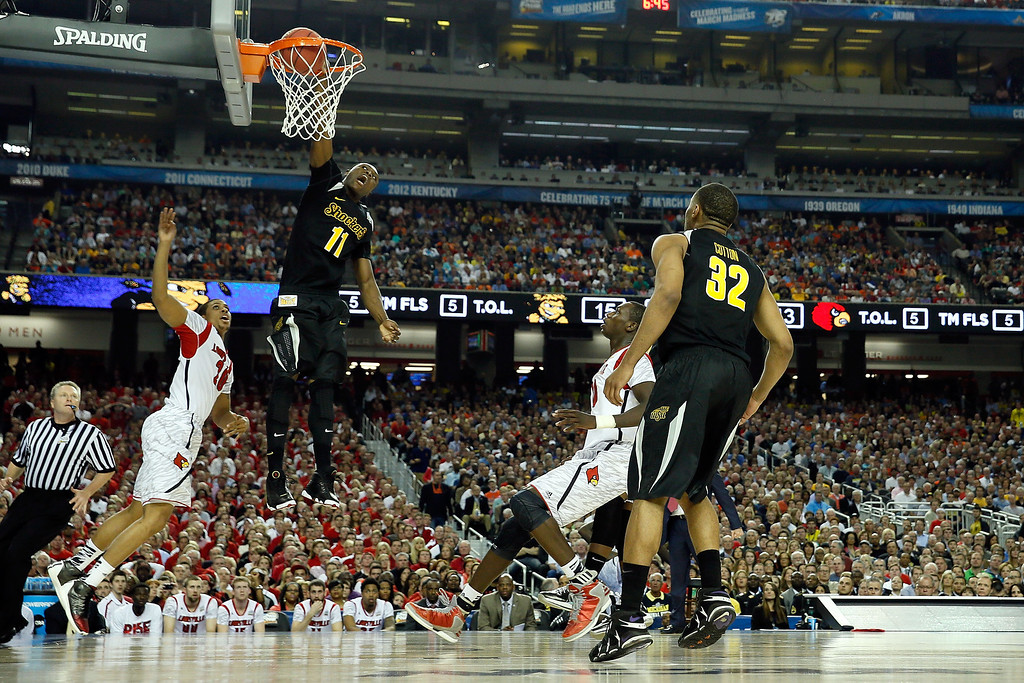 Description of . ATLANTA, GA - APRIL 06:  Cleanthony Early #11 of the Wichita State Shockers dunks in the first half against the Wayne Blackshear #20 of the Louisville Cardinals during the 2013 NCAA Men's Final Four Semifinal at the Georgia Dome on April 6, 2013 in Atlanta, Georgia.  (Photo by Kevin C. Cox REMOTES/Getty Images)