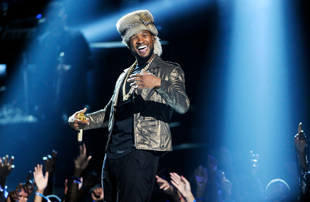 Description of . Usher performs at the BET Awards at the Nokia Theatre on Sunday, June 29, 2014, in Los Angeles. (Photo by Chris Pizzello/Invision/AP)