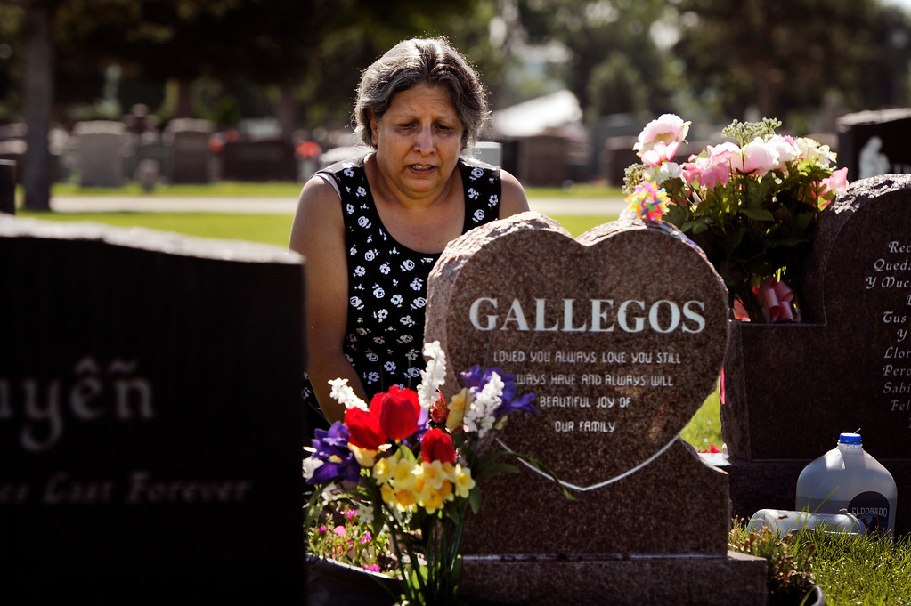 Description of . Janet Gallegos visits the grave of her granddaughter, Neveah Gallegos,  at Mount Olivet Cemetery in Wheat Ridge, CO, Wednesday, August 01, 2012. It would be Neveah's eighth birthday.  Janet  said,