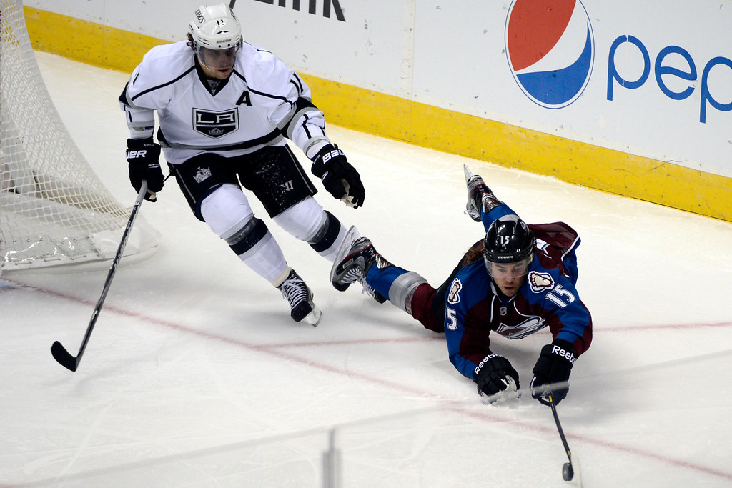 Description of . DENVER, CO. - JANUARY 22: Colorado Avalanche right wing P.A. Parenteau (15) dives between  Los Angeles Kings defenseman Alec Martinez (27) and center Anze Kopitar during the second period. The Colorado Avalanche hosted the Los Angeles Kings at the Pepsi Center on January, 22, 2013.   (Photo By John Leyba / The Denver Post)