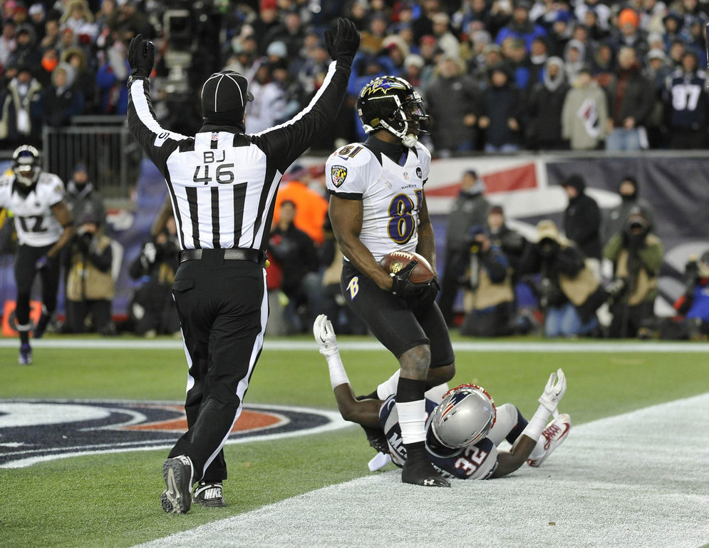 Description of . Baltimore Ravens wide receiver Anquan Boldin (81) scores a touchdown while being covered by New England Patriots free safety Devin McCourty during the fourth quarter in the NFL AFC Championship football game in Foxborough, Massachusetts January 20, 2013. REUTERS/Ray Stubblebine