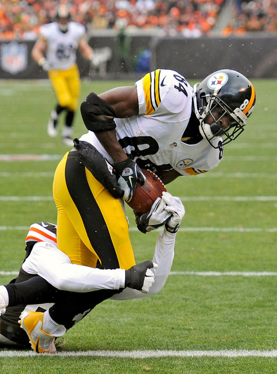 Description of . Pittsburgh Steelers wide receiver Antonio Brown (84) scores on a 41-yard touchdown pass while being defended by Cleveland Browns cornerback Joe Haden in the second quarter of an NFL football game on Sunday, Nov. 24, 2013. (AP Photo/David Richard)