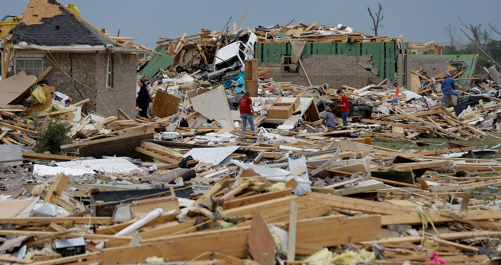 Description of . Volunteers continue to salvage items for residents who lost their homes to Sunday's tornado, Tuesday, April 29, 2014, in Vilonia, Ark.   (AP Photo/Eric Gay)
