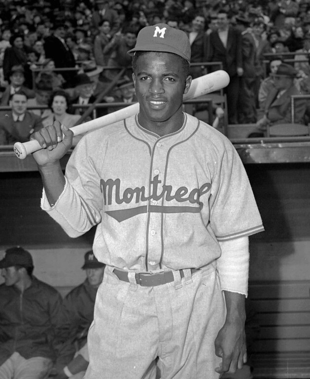 Description of . Montreal Royals Jackie Robinson poses on April 18,1946. Robinson broke the color barrier and changed baseball forever.(AP Photo/John J. Lent)