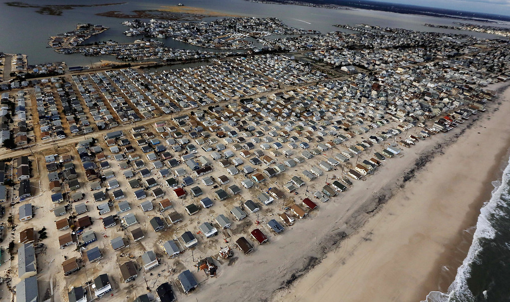. Homes are surrounded by sand washed in by Superstorm Sandy on October 31, 2012 in Seaside Heights, New Jersey. At least 50 people were reportedly killed in the U.S. by Sandy with New Jersey suffering massive damage and power outages. (Photo by Mario Tama/Getty Images)