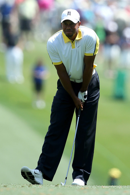 Description of . Tiger Woods of the United States watches a shot on the first hole during the second round of the 2013 Masters Tournament at Augusta National Golf Club on April 12, 2013 in Augusta, Georgia.  (Photo by Andrew Redington/Getty Images)