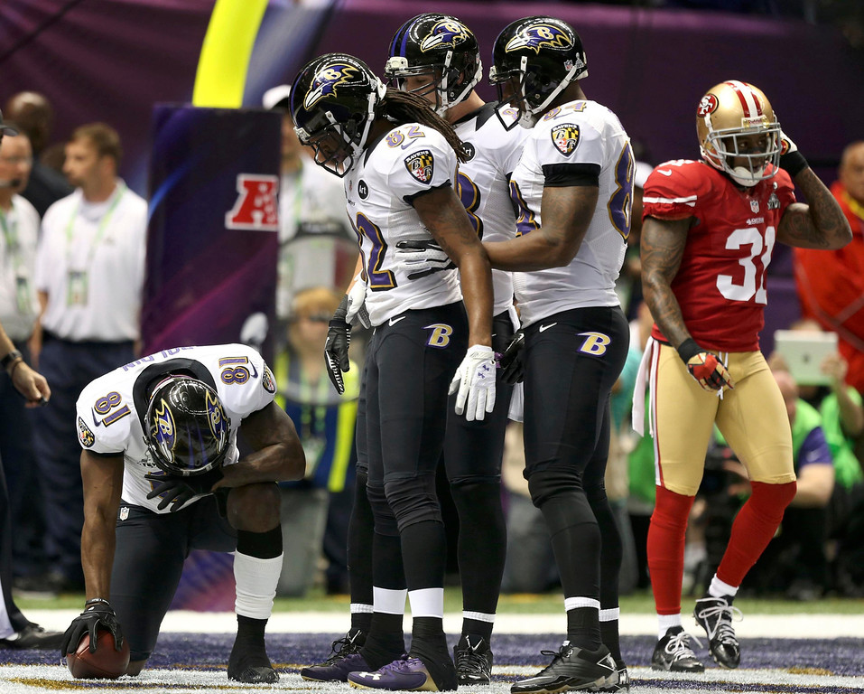 Description of . Baltimore Ravens wide receiver Anquan Boldin (81) reacts in the end zone after catching a touchdown pass as San Francisco 49ers strong safety Donte Whitner (31) walks away during the first quarter in the NFL Super Bowl XLVII football game in New Orleans, Louisiana, February 3, 2013. REUTERS/Sean Gardner