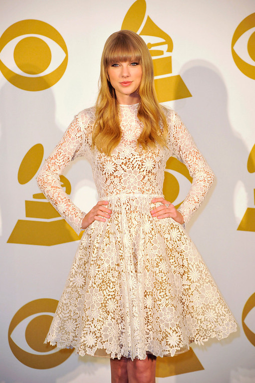 Description of . Co-host Taylor Swift poses for a photo at the Grammy Nominations Concert Live! at Bridgestone Arena on Wednesday, Dec. 5, 2012, in Nashville, Tenn. (Photo by Donn Jones/Invision/AP)