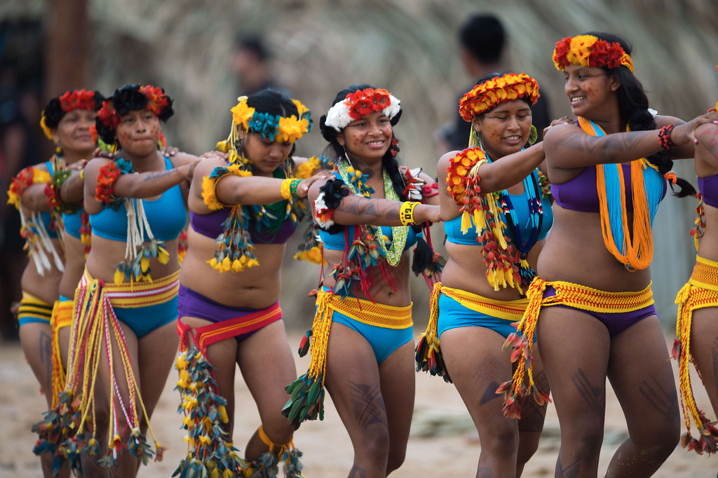 Description of . Brazilian indigenous women of the Bakairi tribe arrive to participate in a tug of war competition during the XII International Games of Indigenous Peoples in Cuiaba, Mato Grosso state, Brazil on November 12, 2013. AFP PHOTO / Christophe SIMON/AFP/Getty Images