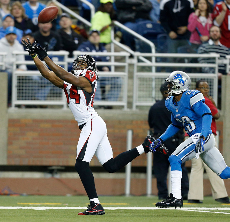 Description of . Atlanta Falcons wide receiver Roddy White, defended by Detroit Lions cornerback Chris Houston (23), reaches for the ball on a touchdown reception during the first quarter of an NFL football game at Ford Field in Detroit, Saturday, Dec. 22, 2012. (AP Photo/Rick Osentoski)