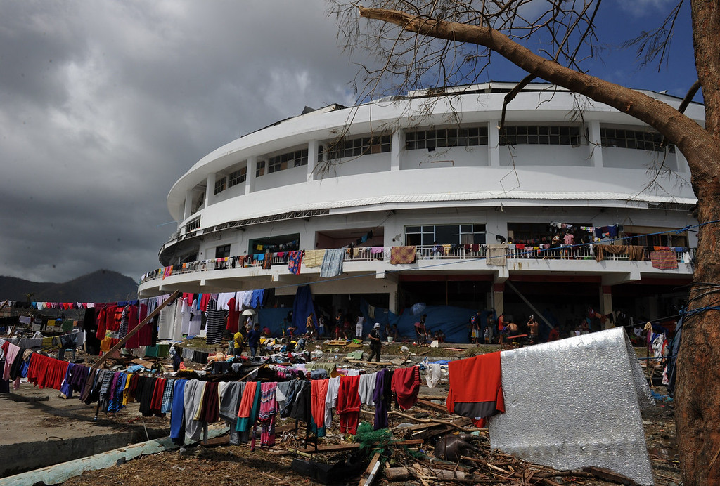Description of . Clothes are put out to dry outside a stadium used as an evacuation centre in Tacloban, Leyte province, central Philippines on November 10, 2013, three days after devastating Typhoon Haiyan hit the city on November 8.  The death toll from a super typhoon that decimated entire towns in the Philippines could soar well over 10,000, authorities warned on November 10, making it the country's worst recorded natural disaster.   TED ALJIBE/AFP/Getty Images