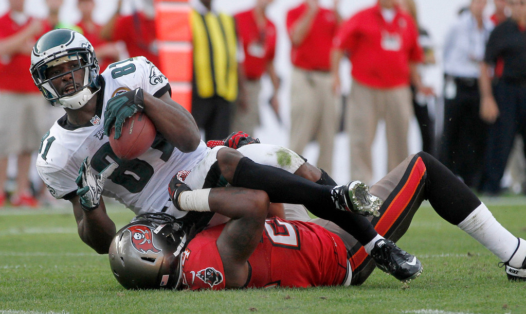 Description of . Philadelphia Eagles wide receiver Jason Avant (81) makes a first down catch over Tampa Bay Buccaneers safety Mark Barron (24) during the second half of an NFL Football game , Sunday, Nov. 9, 2012, in Tampa, Fla. The Eagles won 23-21. (AP Photo/Reinhold Matay)