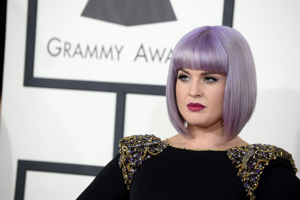 Description of . Kelly Osbourne arrives at the 56th annual GRAMMY Awards at Staples Center on Sunday, Jan. 26, 2014, in Los Angeles. (Photo by Jordan Strauss/Invision/AP)