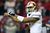 Quarterback Colin Kaepernick #7 of the San Francisco 49ers calls out from under center in the first quarter against the Atlanta Falcons in the NFC Championship game at the Georgia Dome on January 20, 2013 in Atlanta, Georgia.  (Photo by Streeter Lecka/Getty Images)