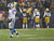 Detroit Lions quarterback Matthew Stafford (L) reacts after  fumbling the ball that was recovered and ran back for a touchdown by Green Bay Packers defensive end Mike Daniels during the first half of a NFL football game in Green Bay, Wisconsin December 9, 2012. REUTERS/Darren Hauck