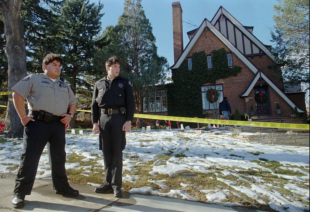 . Boulder Sheriff\'s Department cadets V. Montez, left, and E. Hill stand outside the home in Boulder, Colo., on Dec. 27, 1996, in which 6-year-old JonBenet Ramsey was found dead on December 26. (AP Photo/David Zalubowski, File)