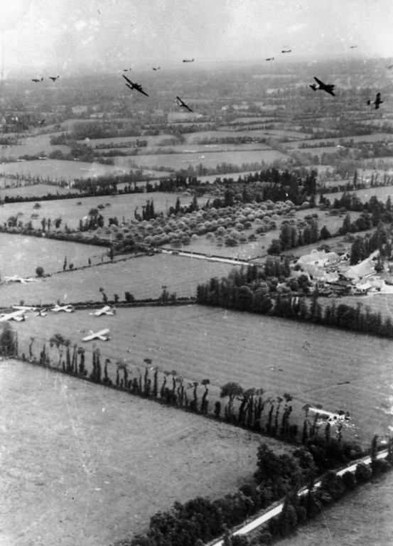 Description of . 6th June 1944:  Taken on D-Day, the fields of Northern France are covered with Waco gliders of the Ninth Air force Troop Carrier Command, whilst other gliders prepare to land, whilst Douglas C 47 glider tugs leave the area.  (Photo by Keystone/Getty Images)
