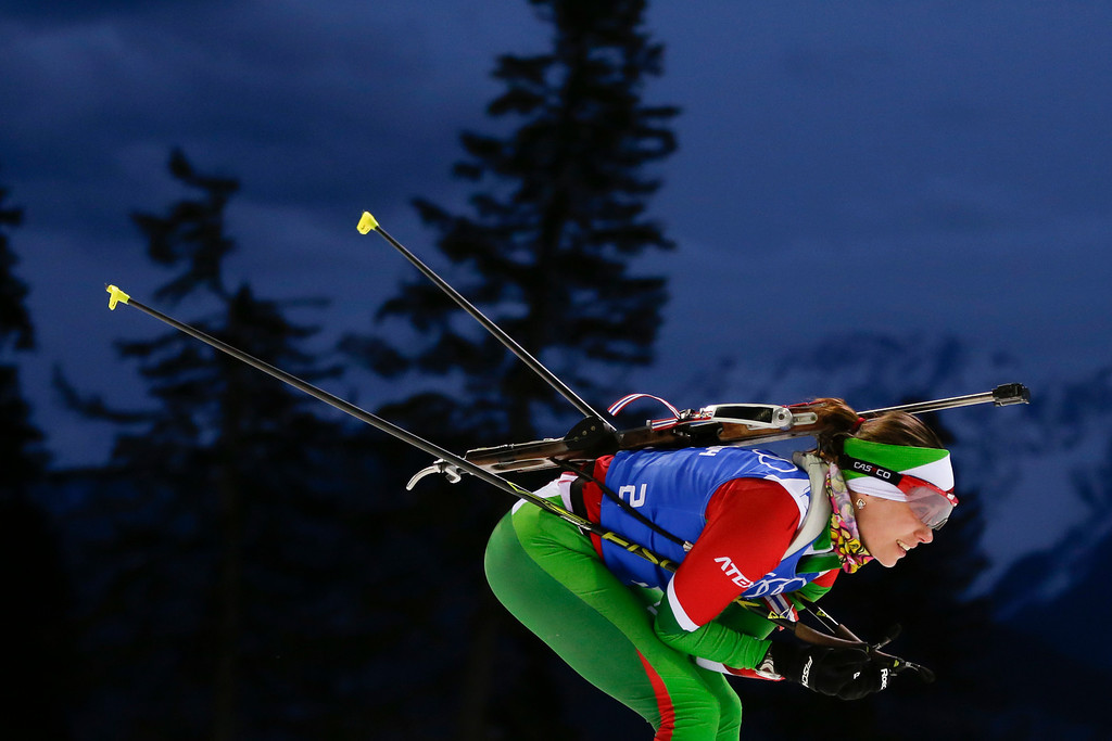 Description of . Belarus\' Nadezhda Skardino skis during a women\'s biathlon training session at the 2014 Winter Olympics, Thursday, Feb. 20, 2014, in Krasnaya Polyana, Russia. (AP Photo/Felipe Dana)