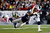 Chandler Jones #95 of the New England Patriots tackels Arian Foster #23 of the Houston Texans during the 2013 AFC Divisional Playoffs game at Gillette Stadium on January 13, 2013 in Foxboro, Massachusetts.  (Photo by Jim Rogash/Getty Images)