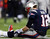 Tom Brady #12 of the New England Patriots sits on the ground after getting knocked down in the fourth quarter against the Baltimore Ravens during the 2013 AFC Championship game at Gillette Stadium on January 20, 2013 in Foxboro, Massachusetts.  (Photo by Elsa/Getty Images)