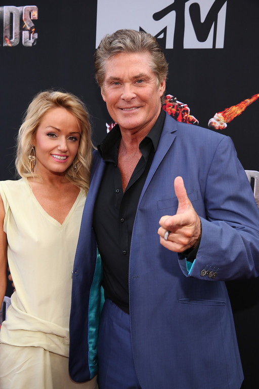 Description of . Actor David Hasselhoff (R) and Hayley Roberts attend the 2014 MTV Movie Awards at Nokia Theatre L.A. Live on April 13, 2014 in Los Angeles, California.  (Photo by Rich Polk/Getty Images for MTV)