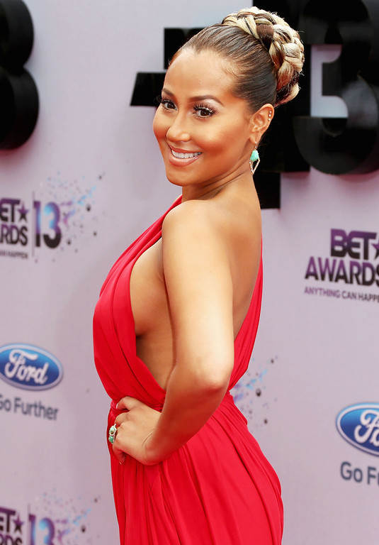 Description of . Recording artist Adrienne Bailon attends the 2013 BET Awards at Nokia Theatre L.A. Live on June 30, 2013 in Los Angeles, California.  (Photo by Frederick M. Brown/Getty Images for BET)