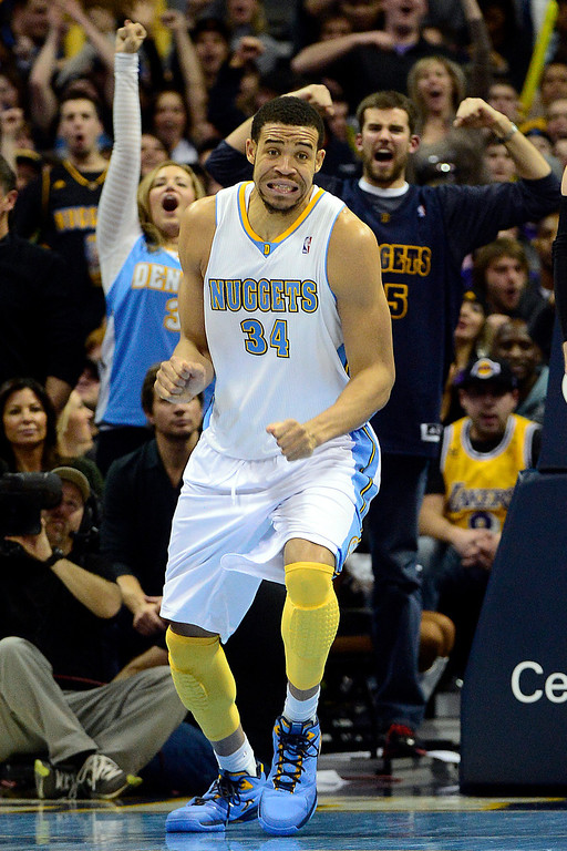 Description of . Denver Nuggets center JaVale McGee (34) reacts to a big dunk against the Los Angeles Lakers during the second half of the Nuggets' 126-114 win at the Pepsi Center on Wednesday, December 26, 2012. AAron Ontiveroz, The Denver Post