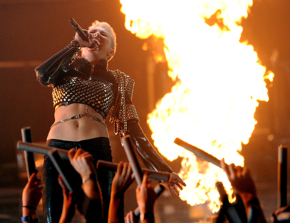 Description of . LOS ANGELES, CA - DECEMBER 16:  Singer Miley Cyrus performs onstage during