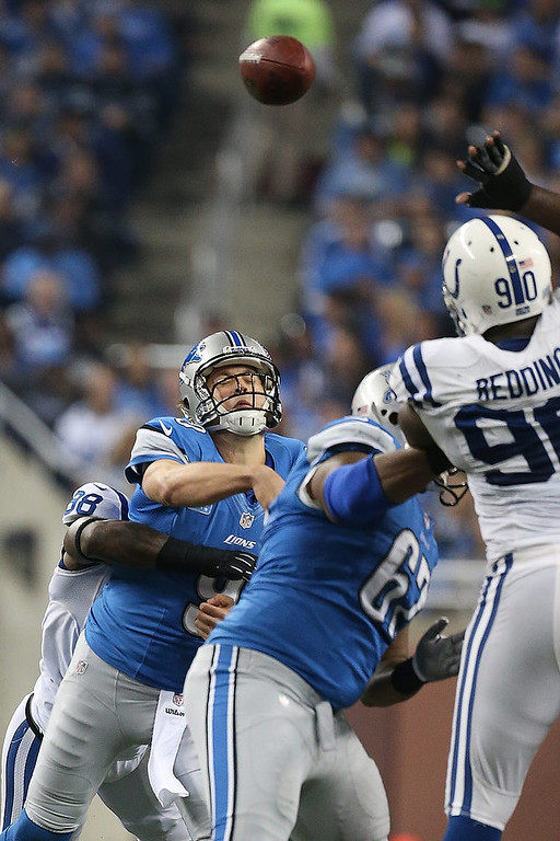 Description of . Sergio Brown #38 of the Indianapolis Colts hits Matthew Stafford #9 of the Detroit Lions during the game at Ford Field on December 2, 2012 in Detroit, Michigan. (Photo by Leon Halip/Getty Images)