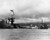 Battle ship Arizona at pearl Harbor, December 1941. The photo was taken shortly after the battleship was bombed and destroyed during the surprise attack by Japanese forces, December 7, 1941. The vessel at right is a rescue tug. Flag still flying the ship is resting on the bottom of the ocean with decks flooded. (AP Photo)