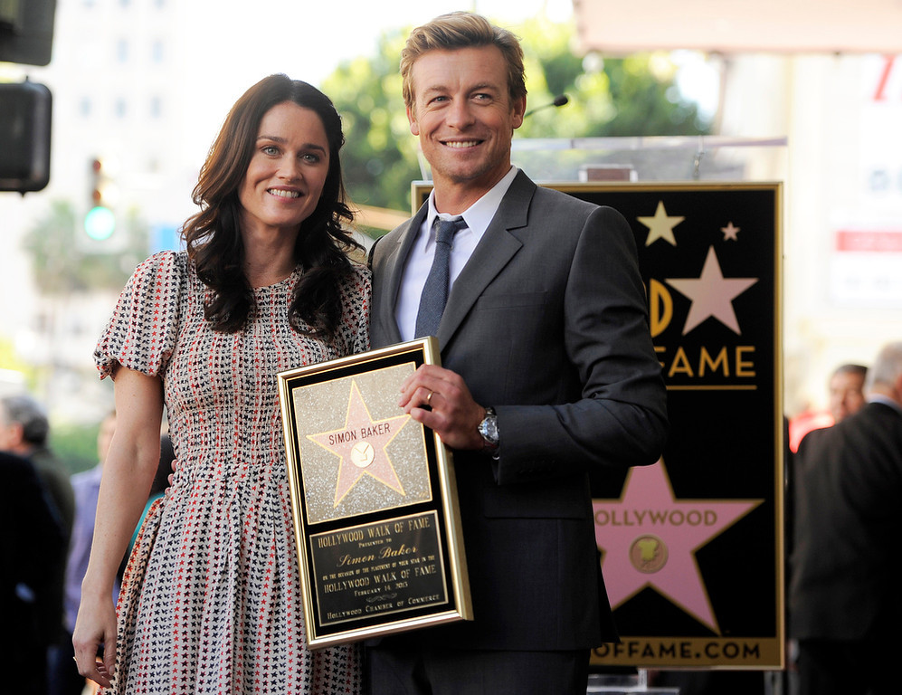". Simon Baker, a cast member in the television series ""The Mentalist,\"" poses with fellow cast member Robin Tunney at a ceremony to award him a star on the Hollywood Walk of Fame, on Thursday, Feb. 14, 2013 in Los Angeles. (Photo by Chris Pizzello/Invision/AP)"