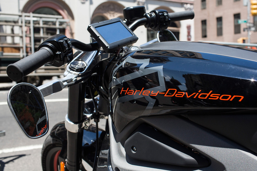 Description of . A Harley Davidson Livewire motorcycle, Harley Davidson's first electric bike, sits on display outside the Harley Davidson Store on June 23, 2014 in New York City. The Livewire has 74 horsepower and a top speed of 92 miles per hour.  (Photo by Andrew Burton/Getty Images)